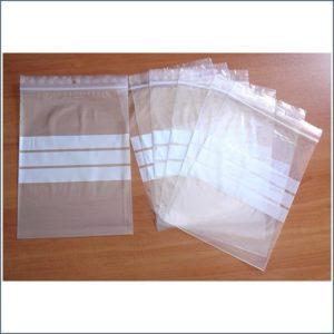 bolsas para comprar con autocierre y franjas blancas en el medio